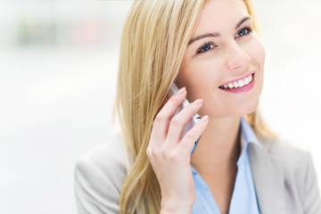 Businesswoman using a mobile phone