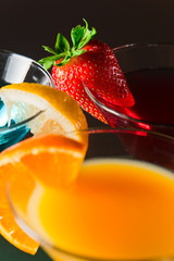 cocktails  with strawberry, lemon and orange