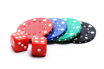 Poker chip and red cubes isolated on white background