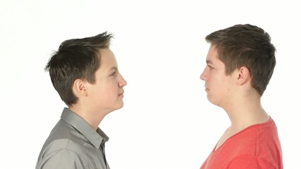 teenager brothers looking at each other, start laughing