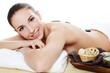 Spa Woman. Stone Massage isolated on white. Skincare