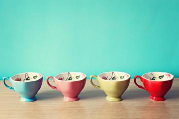 Four Colorful vintage tea cups