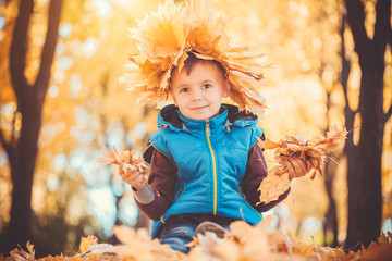 happy playful boy in the autumn park