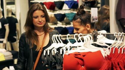 Women shopping in the shop with underwear, steadycam shot