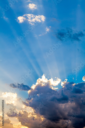 Clouds In The Blue Sky and Sun Rays - 72003456