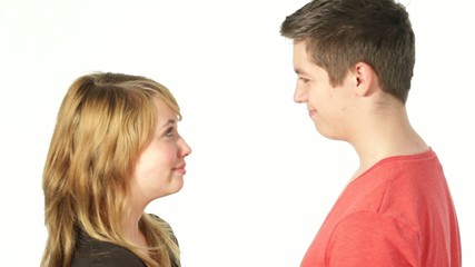 Teenager couple looking at each other, kissing