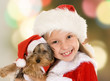 Little girl and dog at Christmas