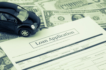 Loan application form with car and money, Sepia toned