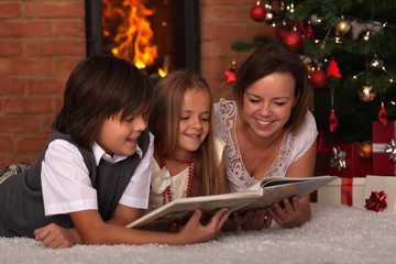 Family reading stories at Christmas time