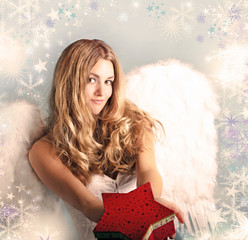 Beautiful female angel with a Christmas present
