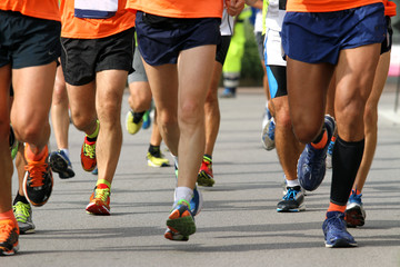 runners engaged in strenuous Marathon