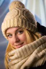 Portrait of the girl in a knitted cap