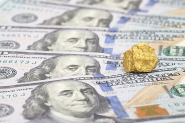 Gold and dollar bills