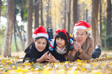 happy family togetherness portrait in forest during christmas