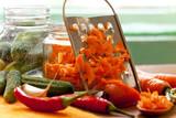 preparing vegetables in jars