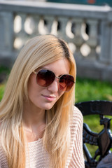 Blonde young woman wearing sunglasses