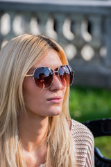 Blonde attractive woman wearing sunglasses