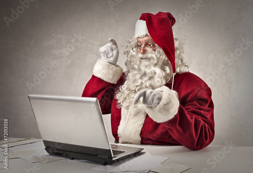 canvas print picture Santa typing on pc