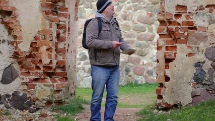 Hiker filmed  in ruins