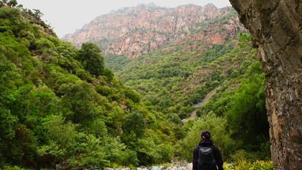 Female tourist enjoying beautiful view in the mountains, Corsica