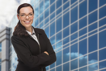 Confident Mixed Race Woman in Front of Corporate Building