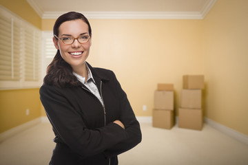 Mixed Race Woman in Empty Room with Boxes