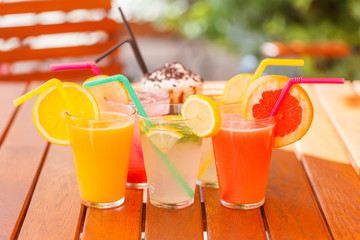 Fresh juices in glasses, outdoors