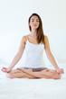 Beautiful young woman doing yoga exercises.