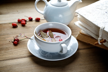Rosehip tea with books in the background