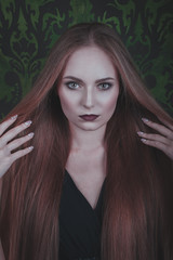 Halloween. Fashion portrait of witch or night vampire woman.