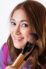 Make-up Artist, beautiful make up artist holding brushes