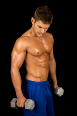 man fitness no shirt on black hold weights down