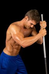 man fitness no shirt on black pole look down