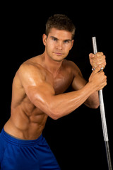 man fitness no shirt on black pole look serious