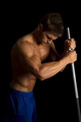 man fitness no shirt on black pole side light look down