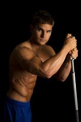 man fitness no shirt on black pole side light look