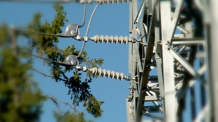 Conductor attachment & Insulators on a high-voltage tower.