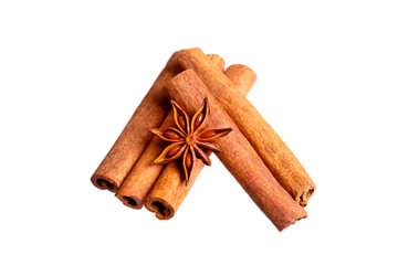 Cinnamon sticks and anise stars on white