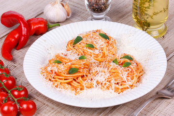 Italian pasta with tomato sauce, cheese and mint