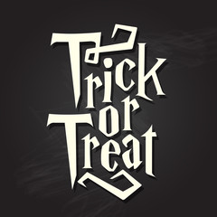 Trick or treat halloween typography quote on chalkboard