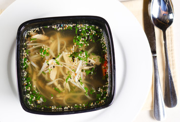 Chicken noodle soup with herbs