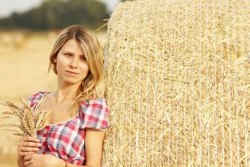 young girl near haystacks