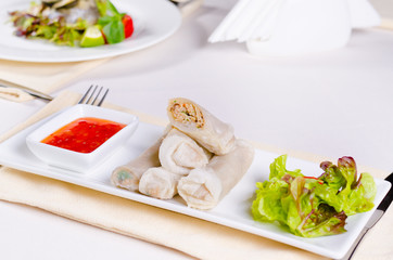 Tasty Sliced Spring Rolls with Lettuce and Sauce
