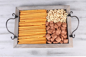 Biscuits and dry breakfast in a box on wooden background