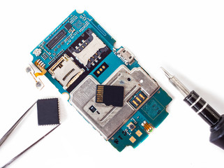 tools and disassembled phone memory card