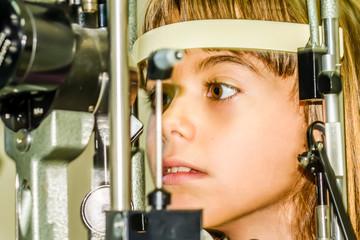 Litlle girl taking the eye exam test