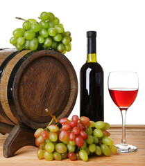 Wine in goblet and in bottle, grapes and barrel