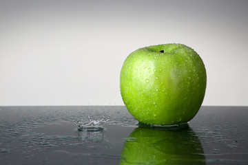 Green apple with water drop