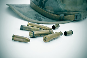 camouflage cap and bullets