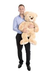 Eltern werden oder Mann in Elternzeit hält Teddy Bär isoliert
